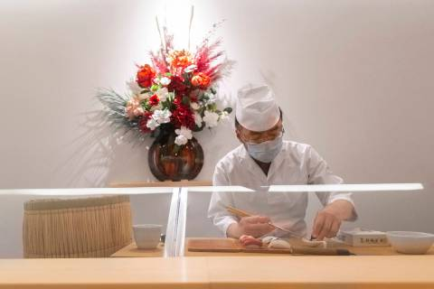 Executive chef Kaz Iida prepares sushi at Yui Edomae Sushi on Thursday, May 28, 2020, in Las Ve ...