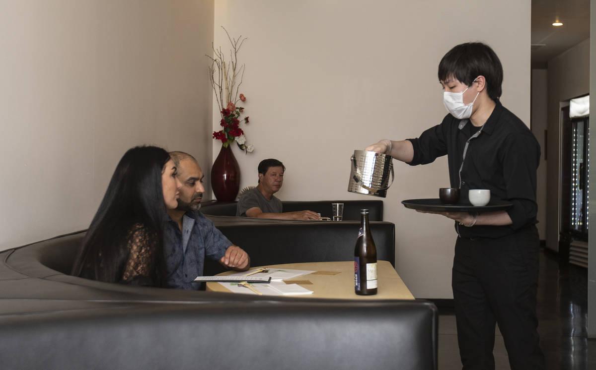 Roy Cheng serves guests at Yui Edomae Sushi on Thursday, May 28, 2020, in Las Vegas. (Benjamin ...