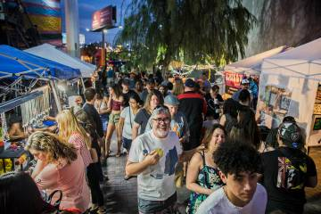 "The streets in the Arts District are packed during First Friday's ""Beat Street"" event ..."