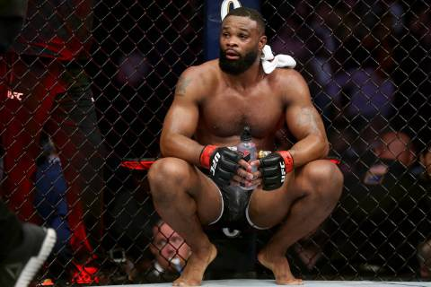 Tyron Woodley reacts after his fight against Kamaru Usman in the welterweight title bout during ...