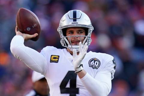 Oakland Raiders quarterback Derek Carr throws a pass during the first half of an NFL football g ...