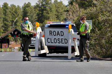 Park Rangers close the entrance to the Grand Canyon for the day Friday, May 15, 2020, in Grand ...
