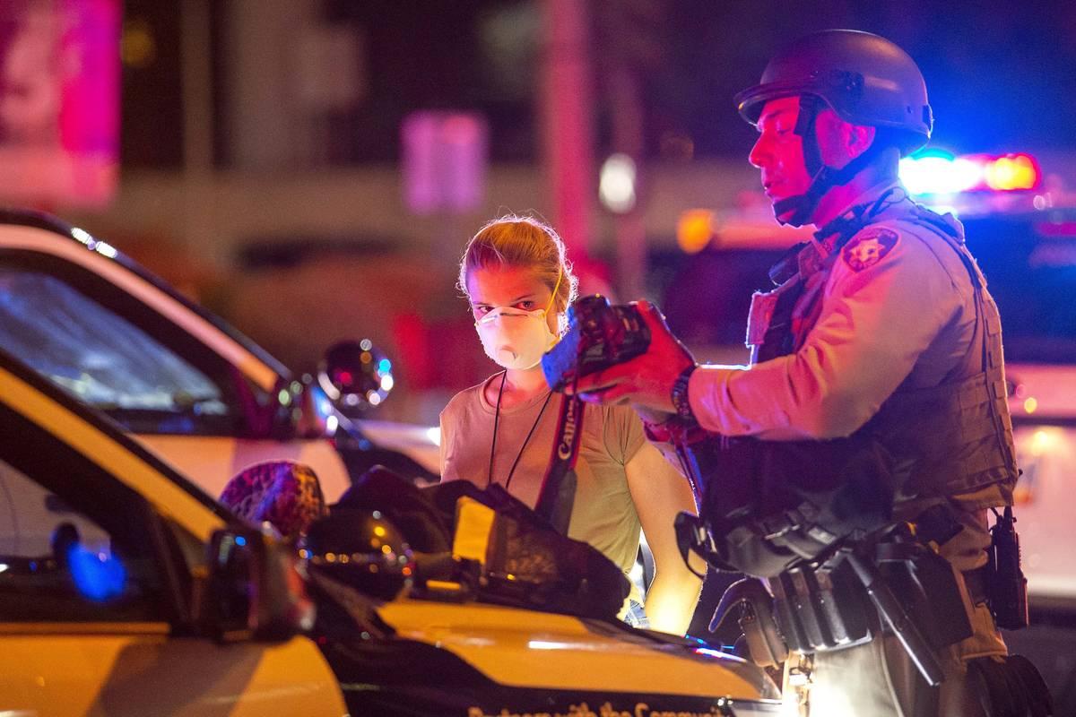 Las Vegas Review-Journal staff photographer Ellen Schmidt is arrested by Metropolitan Police of ...