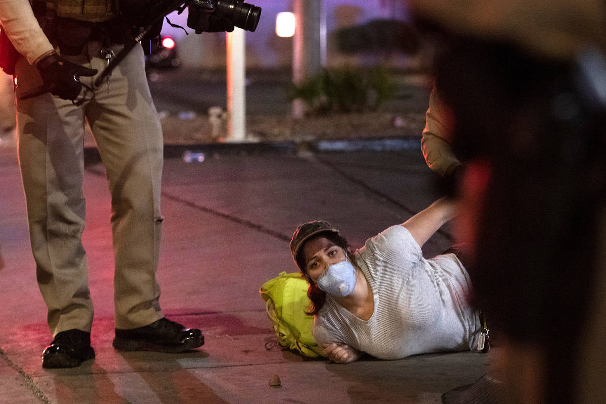 Photojournalist Bridget Bennett is arrested by Metropolitan Police officers while covering a pr ...