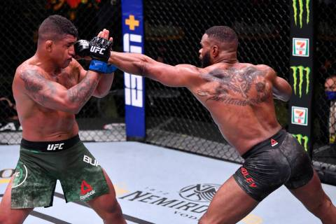 LAS VEGAS, NEVADA - MAY 30: (R-L) Tyron Woodley punches Gilbert Burns of Brazil in their welter ...