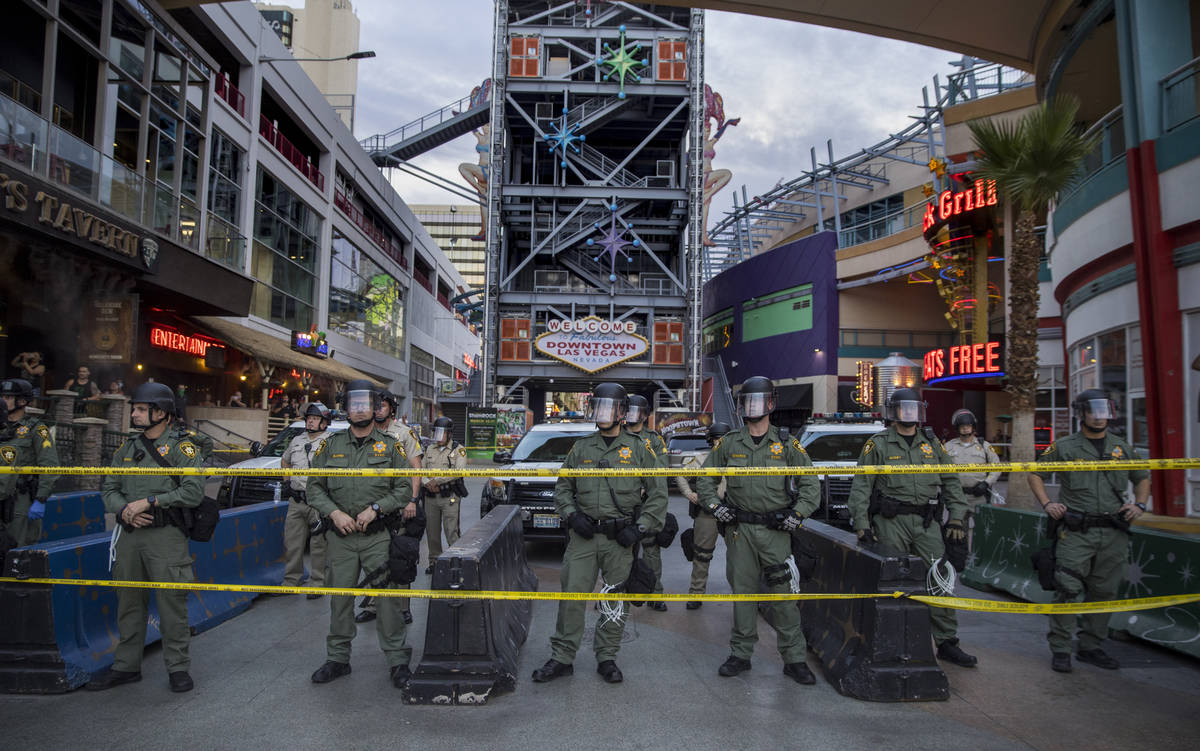 Police secure the Fremont Street Experience from protesters along Fremont Street during a Black ...