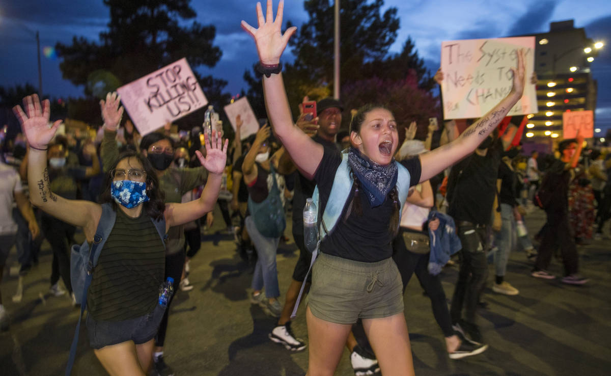 """Protesters yell """"Hands up, don't shoot"""" to police nearby as they march up 7th Street ..."""