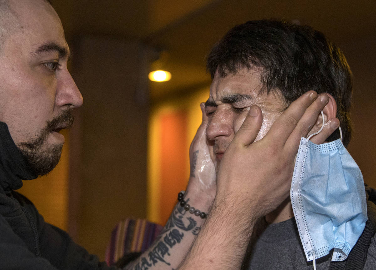 A protester, right, receives some medical attention after being tear gassed by Las Vegas Police ...