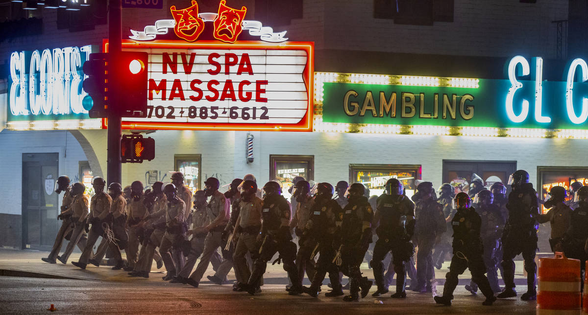 Las Vegas Police advance up Fremont Street on protesters as chaos erupts during a Black Lives M ...