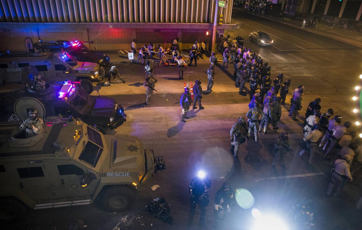 Las Vegas Police move down Las Vegas Blvd. towards protesters as chaos erupts during a Black Li ...