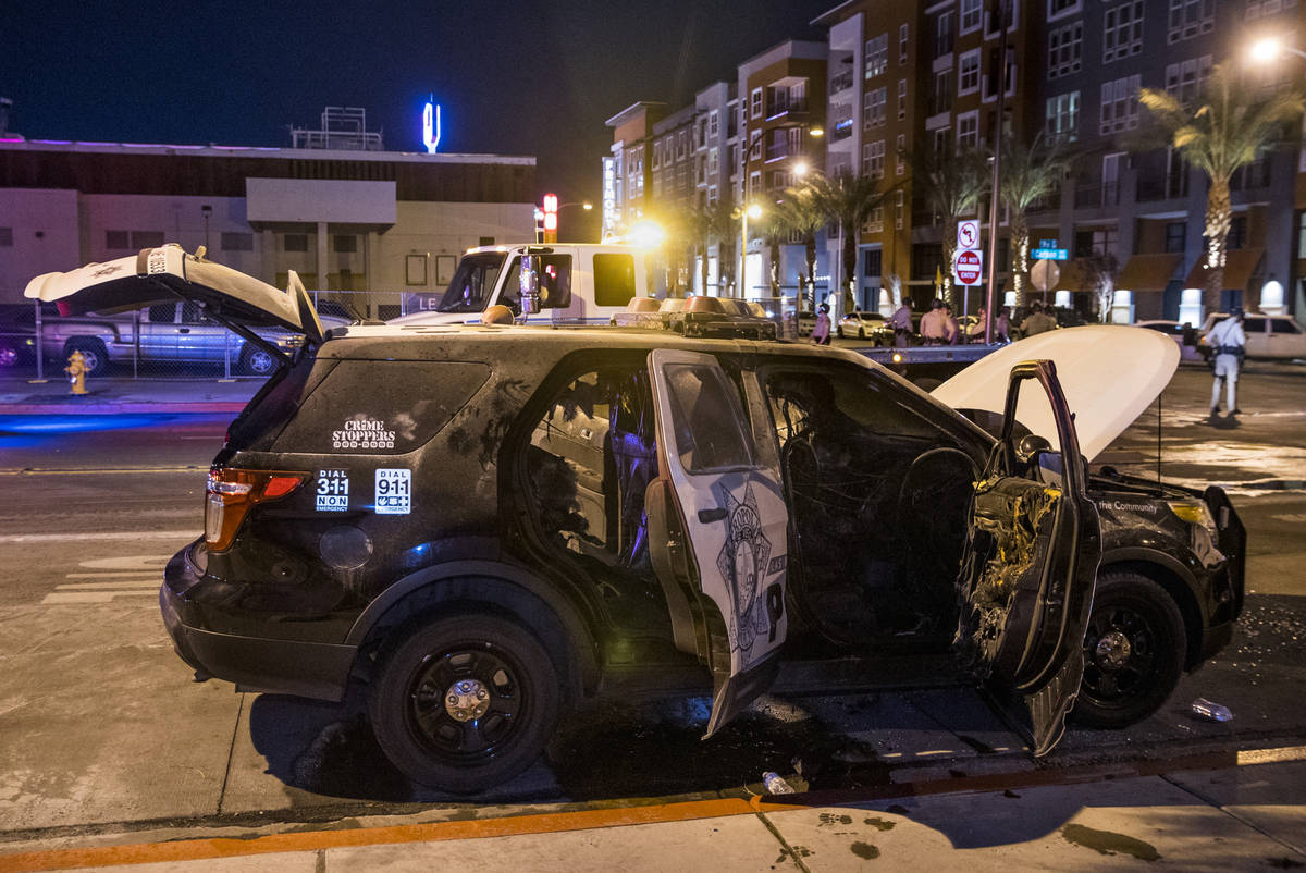 A Las Vegas Police vehicle was set afire on E. Carson Ave at Ninth Street following conflicts d ...