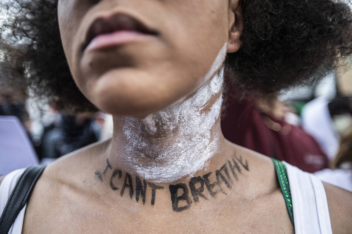 A large crowd protests in downtown Las Vegas during an event organized by Black Lives Matter on ...