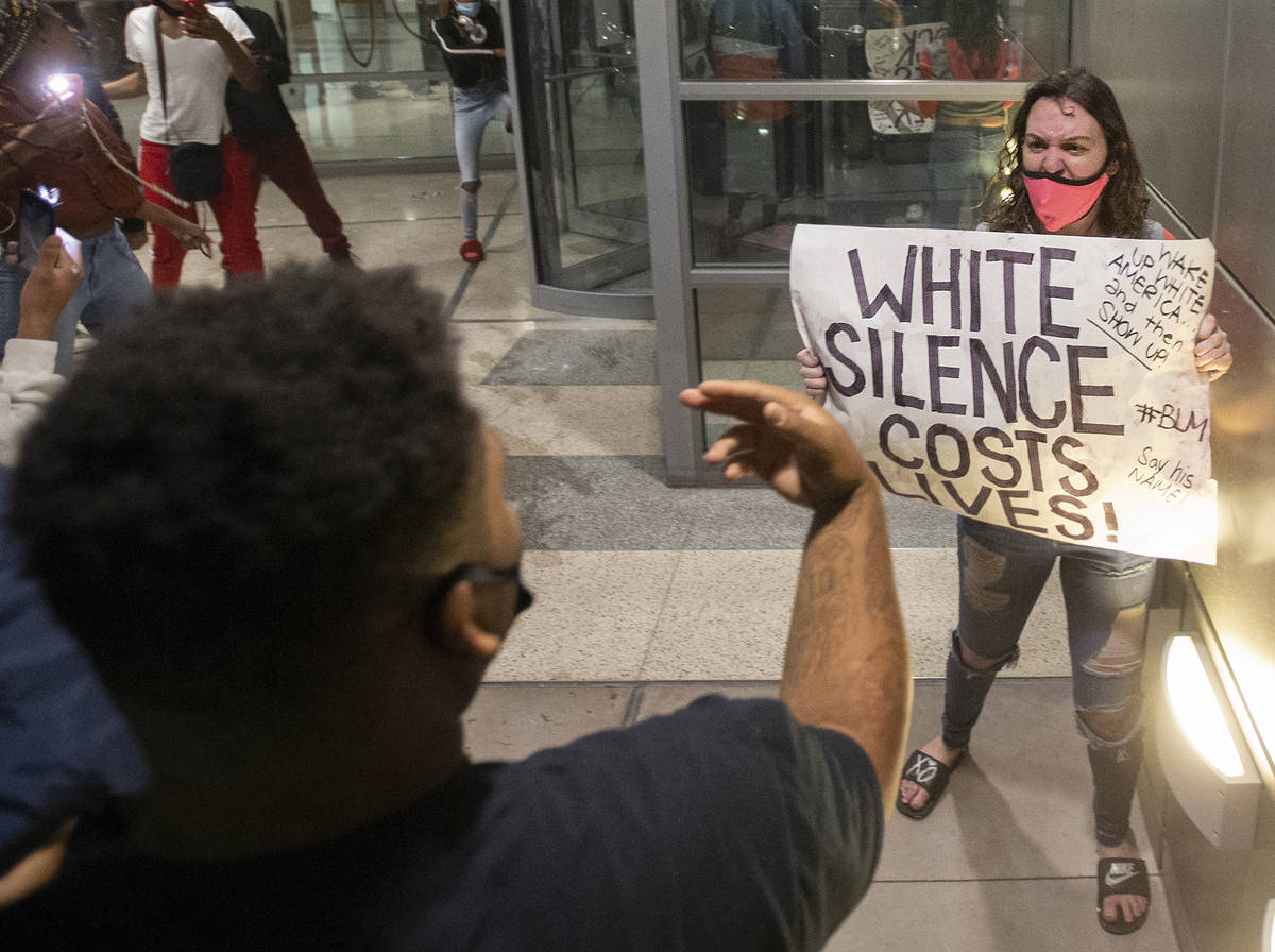 Protesters argue in downtown Las Vegas during an event organized by Black Lives Matter on Satur ...