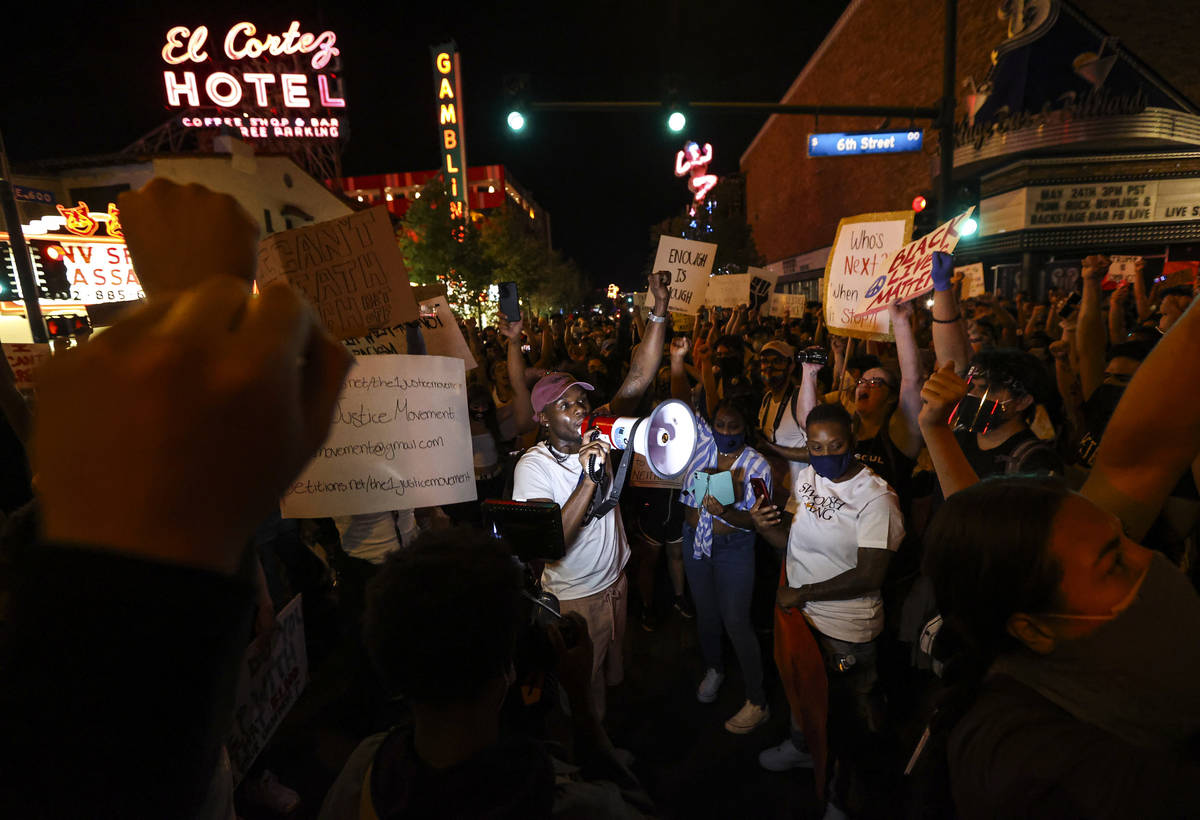 A man speaks as people protest the death of George Floyd in downtown Las Vegas on Saturday, May ...