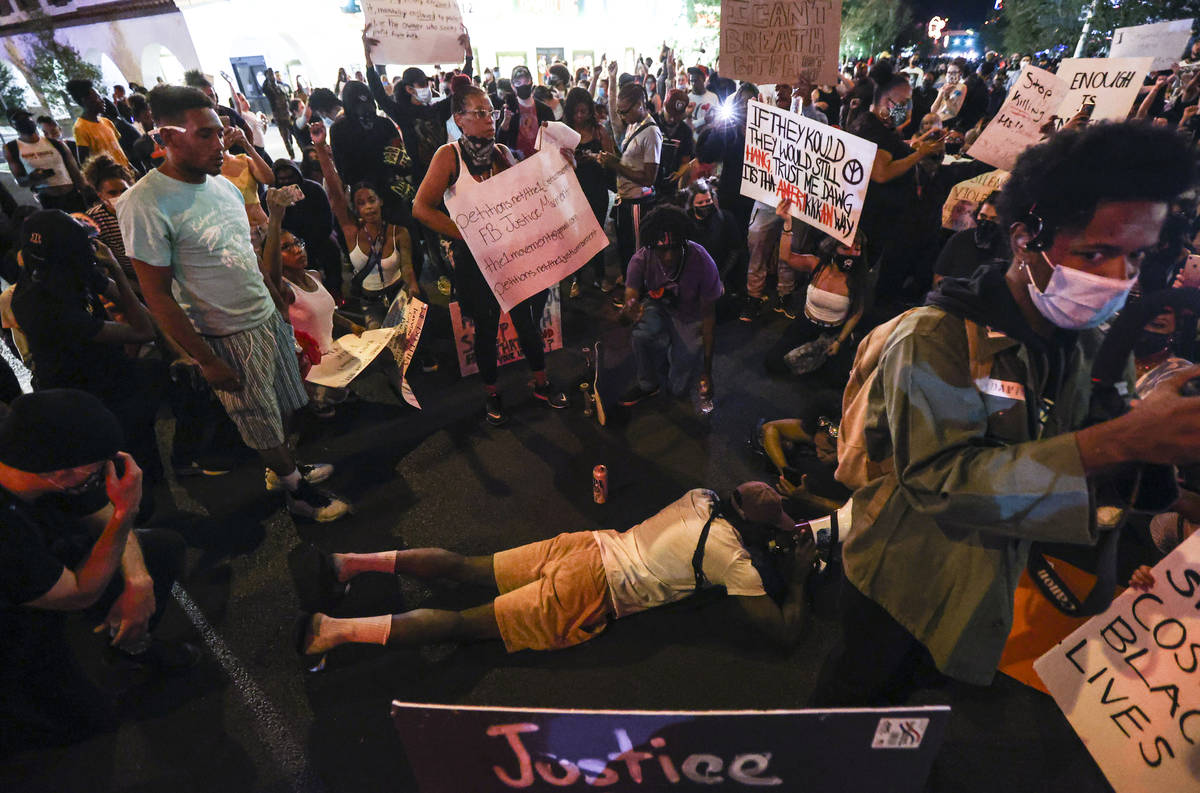 People protest the death of George Floyd in downtown Las Vegas on Saturday, May 30, 2020. (Chas ...