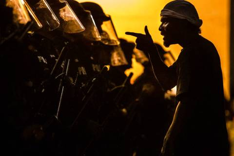 A protester vents at a line of Tucson Police Officers in riot gear at Cushing Street and Church ...