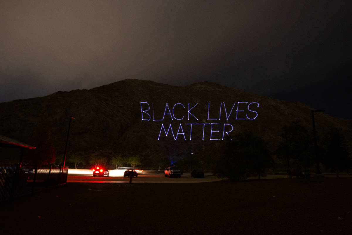 """""""Black Lives Matter"""" is projected onto the side of Lone Mountain by the company Tag Team Produc ..."""