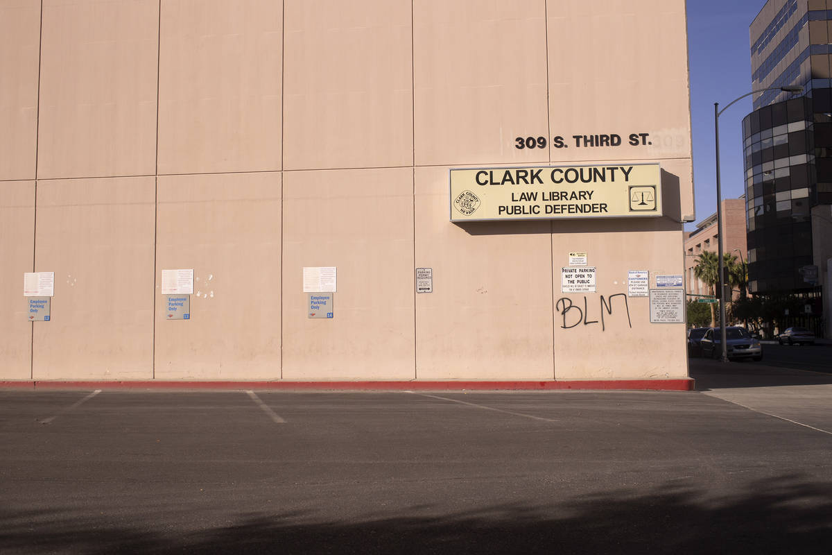 Black Lives Matter graffiti is spray painted on the Clark County Law Library following a night ...