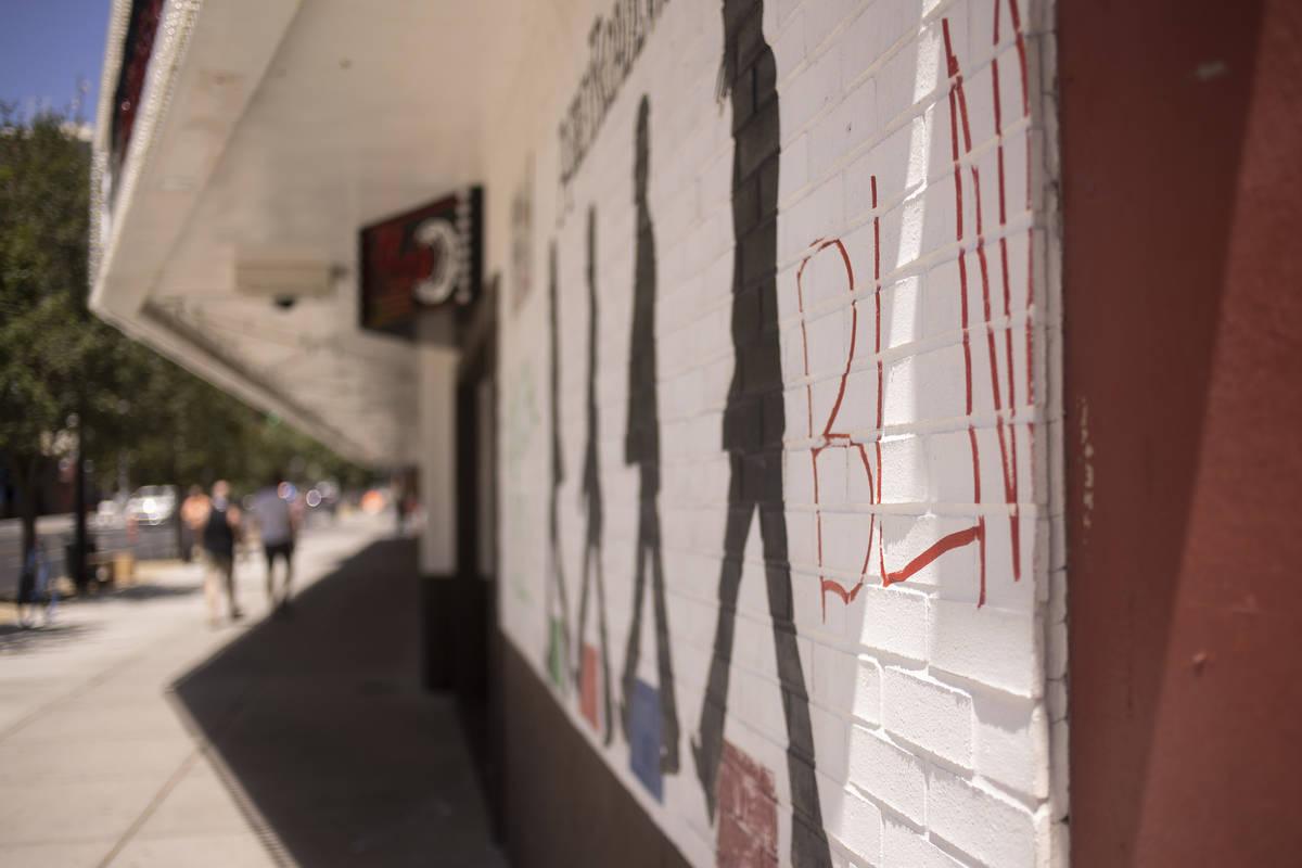 Black Lives Matter is abbreviated in graffiti on the El Cortez hotel-casino following a night o ...