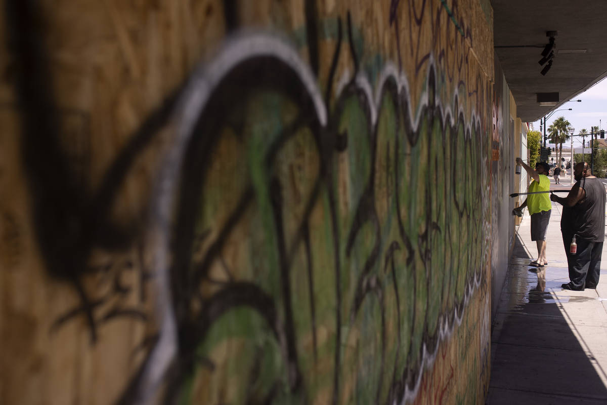 Graffiti is clean off of the boarded up Eureka! Discover American craft following a night of pr ...