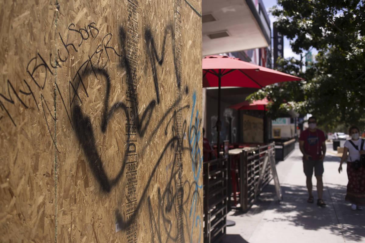 "Graffiti abbreviating ""black lives matter"" and saying ""my black sons matter&quot ..."