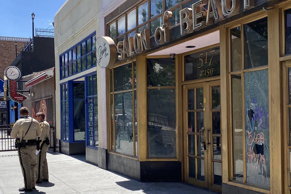 Broken windows are seen Sunday morning at the shuttered Beauty Bar. (Mick Akers/Las Vegas Revie ...