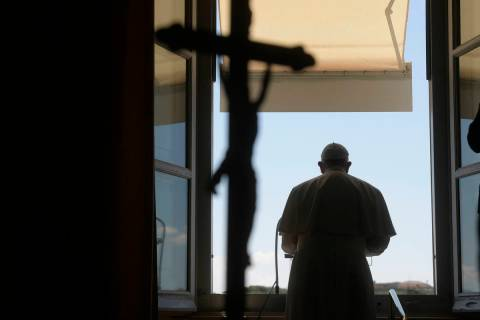 Pope Francis delivers his blessing from his studio window overlooking St. Peter's Square at the ...