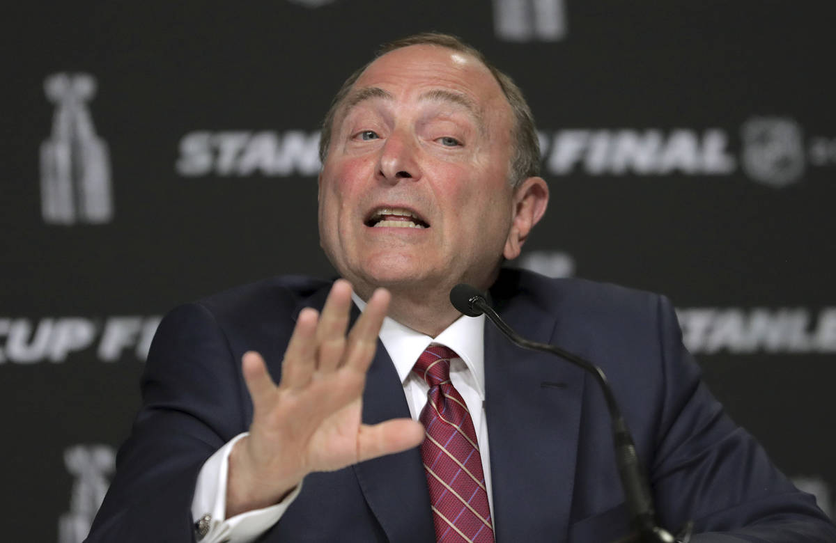FILE - In this May 27, 2019, file photo, NHL Commissioner Gary Bettman speaks to the media befo ...