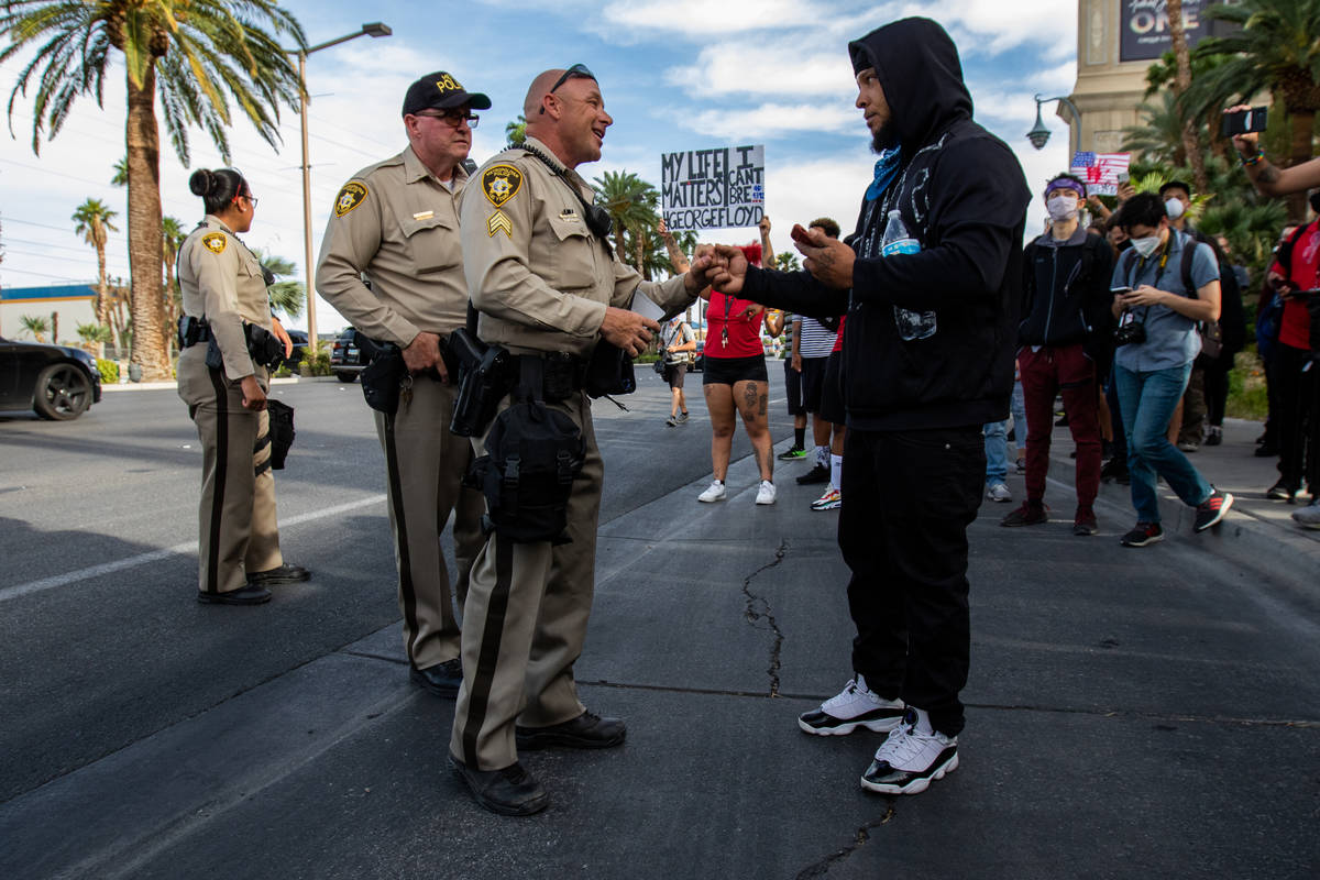 A demonstrator negotiates with police during a Black Lives Matter protest along the Strip on Su ...