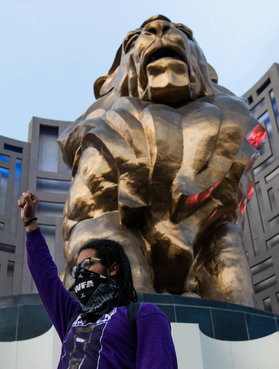 A demonstrator stands with his fist in the air outside MGM Grand on Sunday, May 31, 2020, in La ...