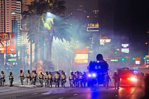 Las Vegas police fire tear gas at Black Lives Matter protesters on Sunday, May, 31, 2020, on th ...