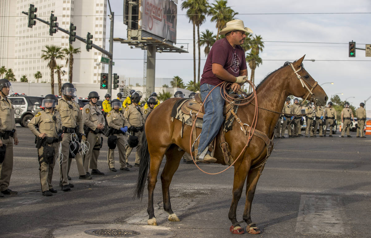 A cowboy joins police during a Black Lives Matter protest on the Las Vegas Strip on Sunday, May ...