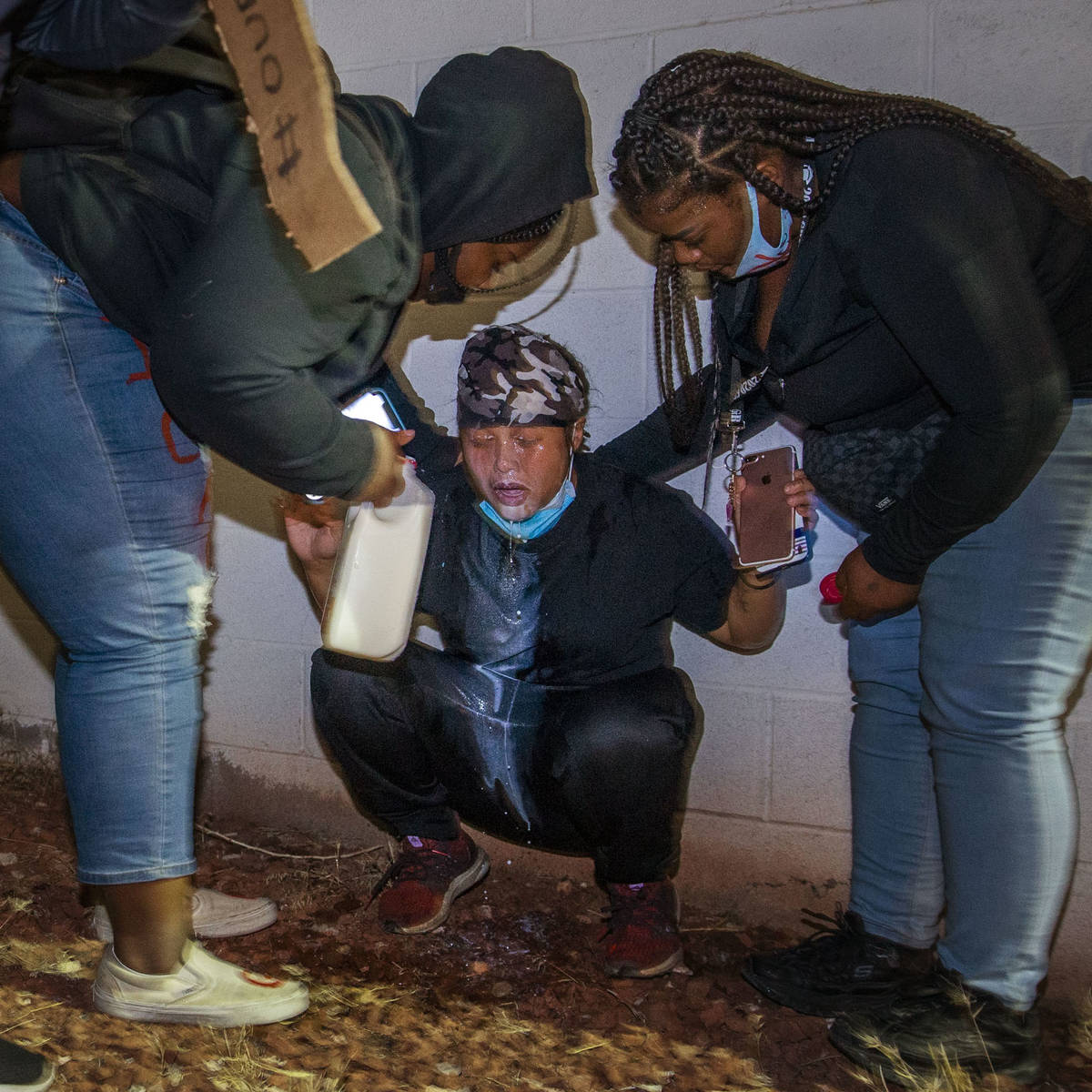Protesters come to the aid of another who was tear gassed by Las Vegas police during a Black Li ...