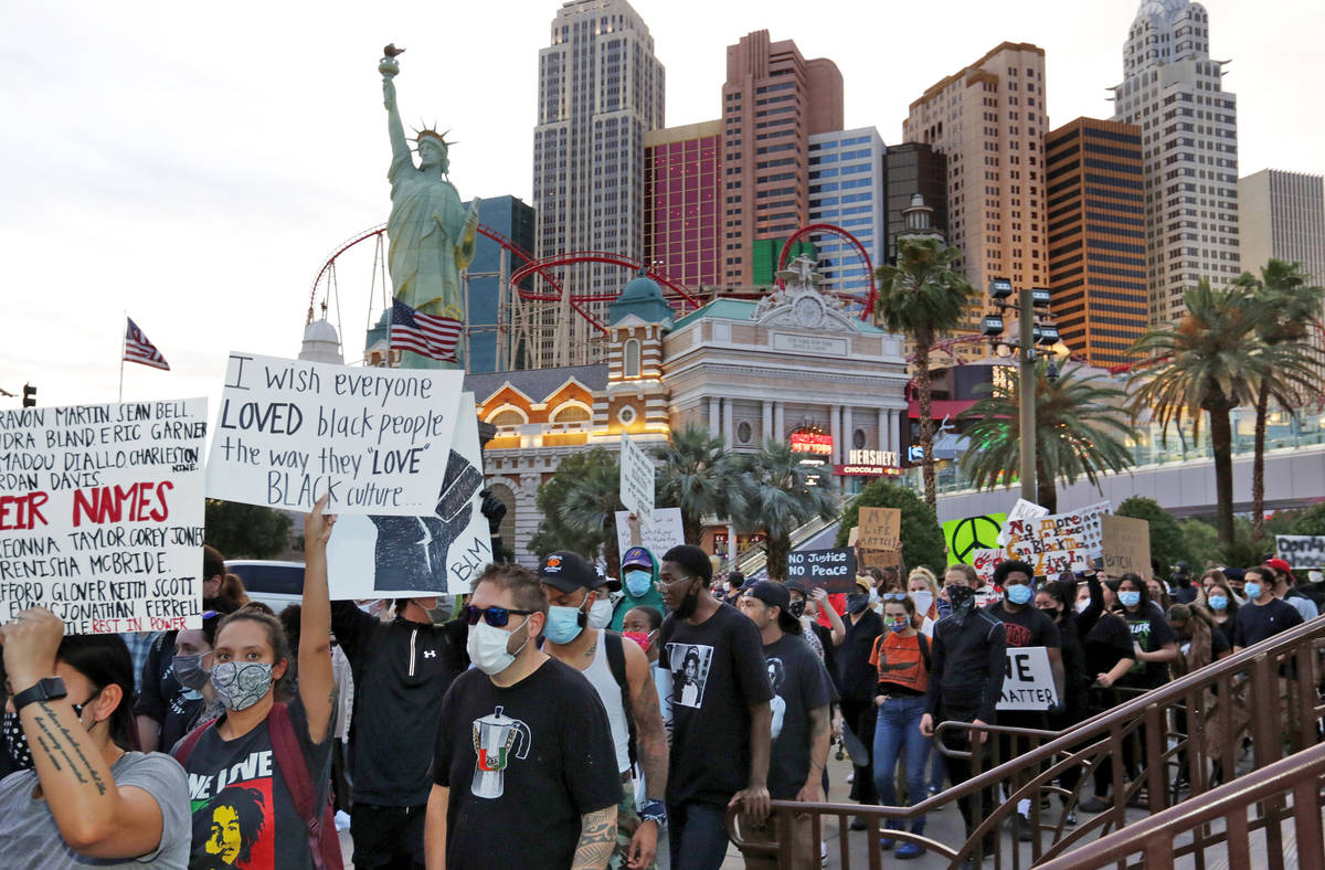 People march along the Las Vegas Strip, Sunday, May, 31, 2020, during a protest over the death ...