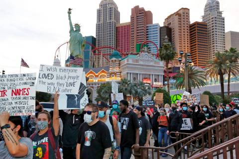 People march around the Las Vegas Strip, Sunday, May, 31, 2020, during a protest over the death ...