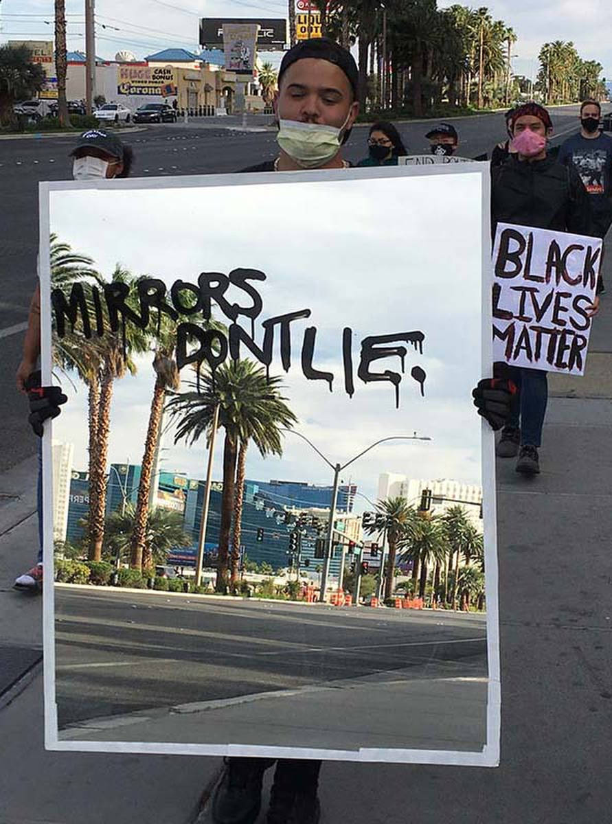 Audra Kelly, a 27-year-old Las Vegas artist, carries a 30-pound mirror at the Black Lives Matte ...
