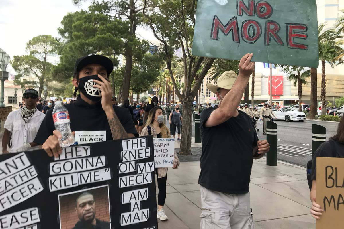 Garry Jones, left, takes part in the Black Lives Matter march on the Las Vegas Strip, Sunday, M ...