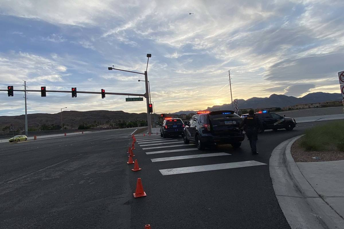 The Nevada Highway Patrol blocks an entrance near Downtown Summerlin, Sunday, May 31, 2020. (Mi ...
