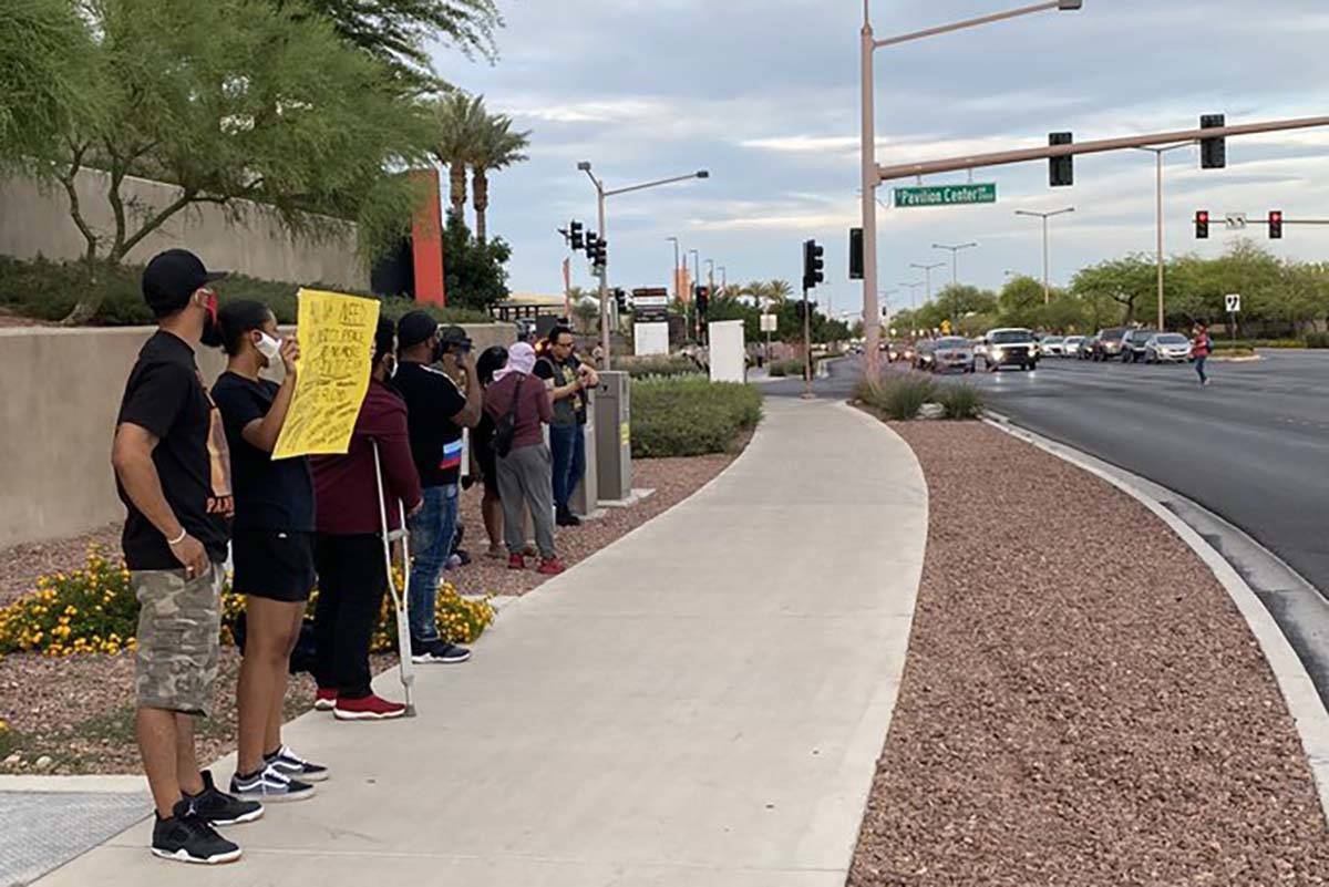 Black Lives Matter protesters stand outside Downtown Summerlin, Sunday, May 31, 2020. (Mick Ake ...