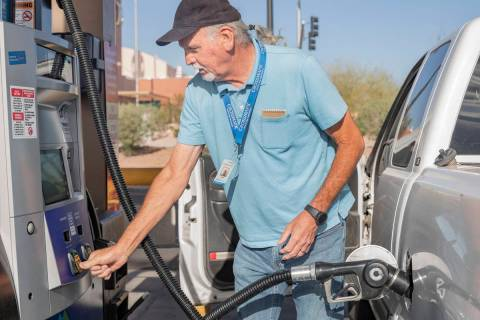 Jim Browning of Pahrump, fills up his gas tank at Sam's Club on East Serene Ave., in Las Vegas ...