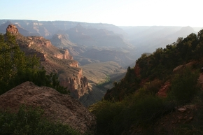 Early morning sunlight glows along the Bright Angel Trail at the South Rim of Grand Canyon Nati ...