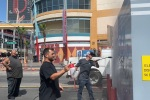 Las Vegans clean up litter-strewn streets, take photos after protest