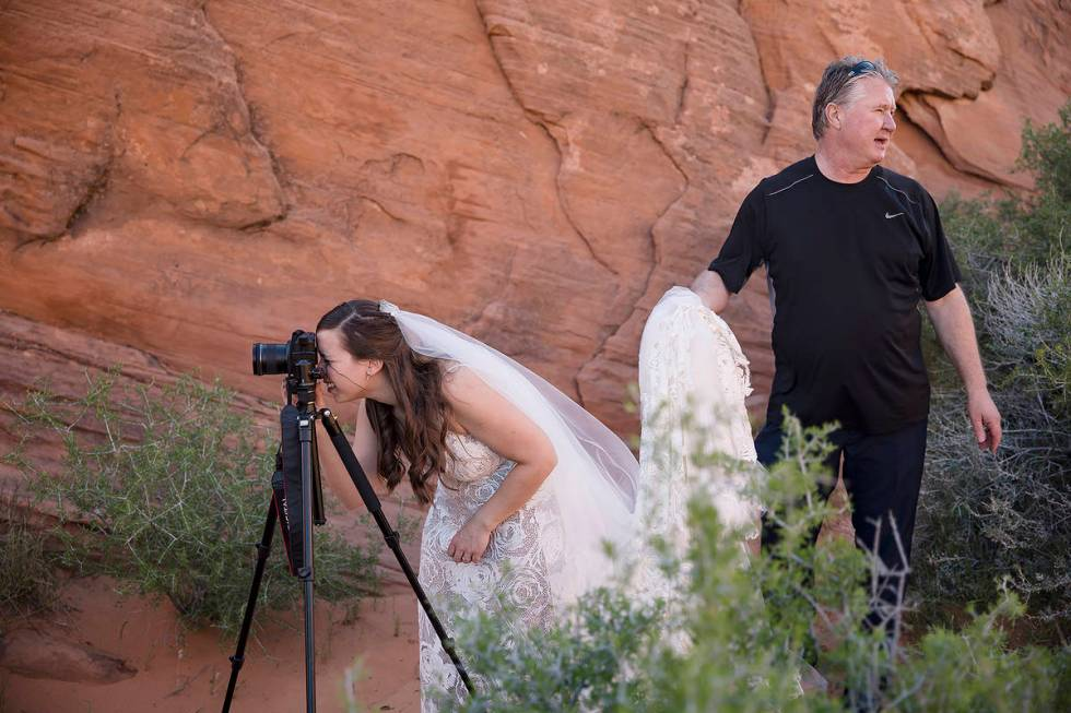 Ashley Johns sets up her camera to record the ceremony, which was moved to Valley of Fire State ...