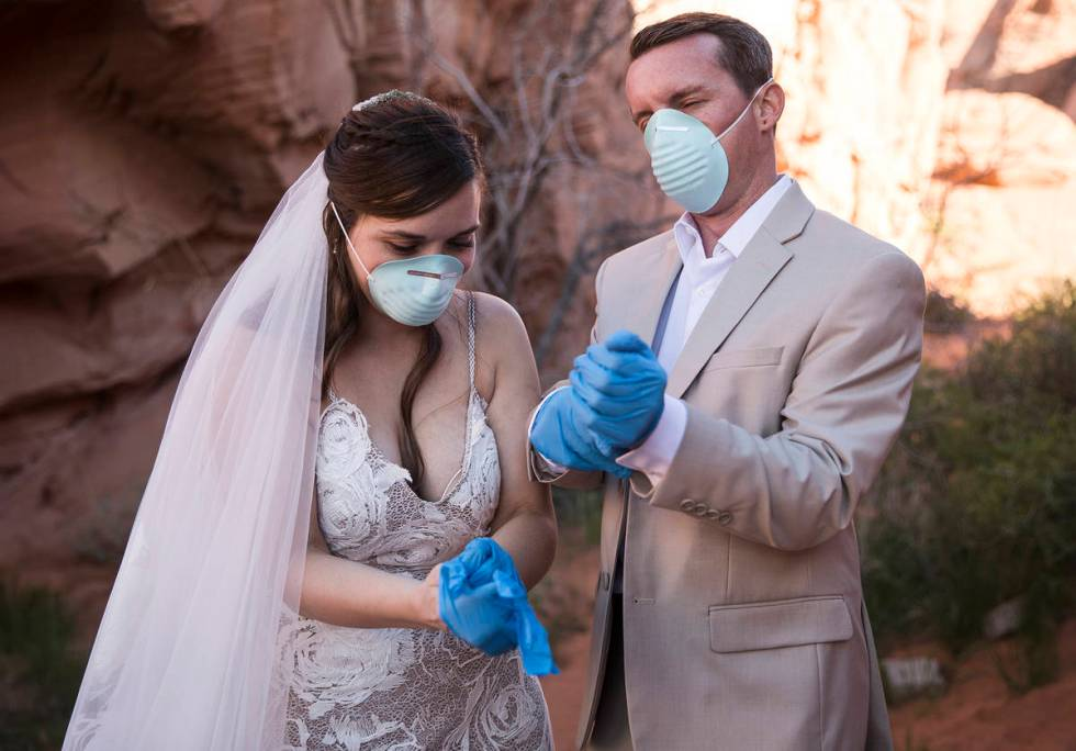 After the ceremony, Ashley and Will Hinder don protective gear for photos to commemorate the da ...