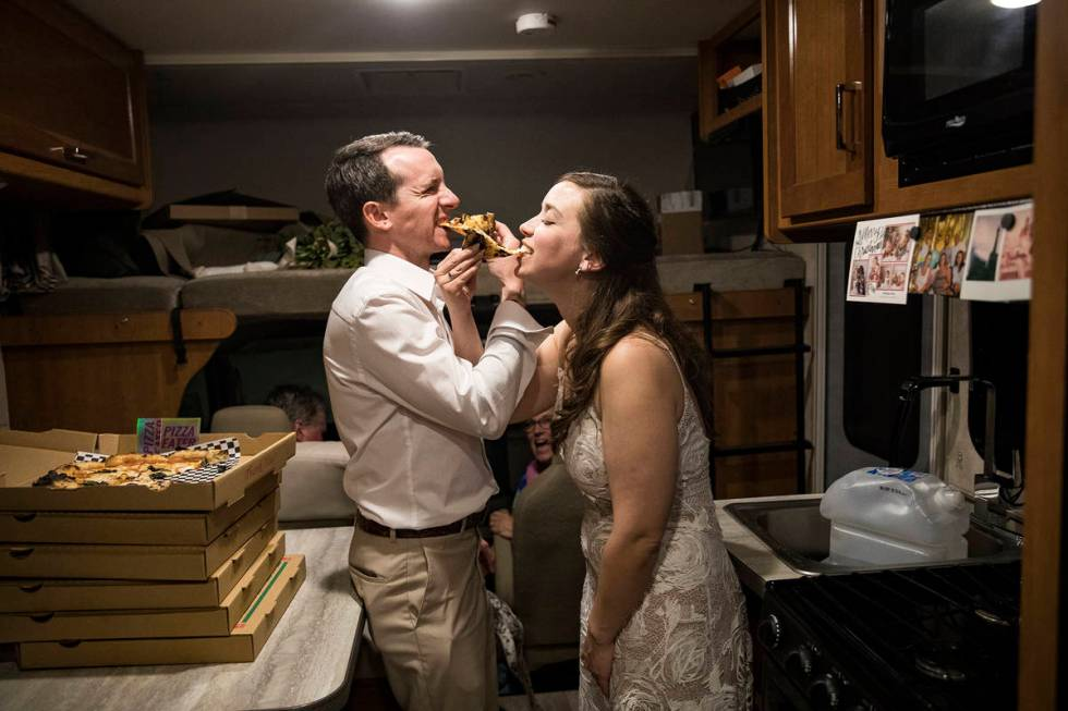 The newlyweds share a pizza toast in the RV in which her mother and stepfather had spent the pr ...