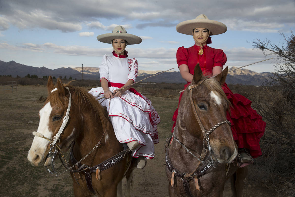 Alondra Colon, left, and her sister Viridiana, pose at Sandy Valley Ranch after a performance. ...