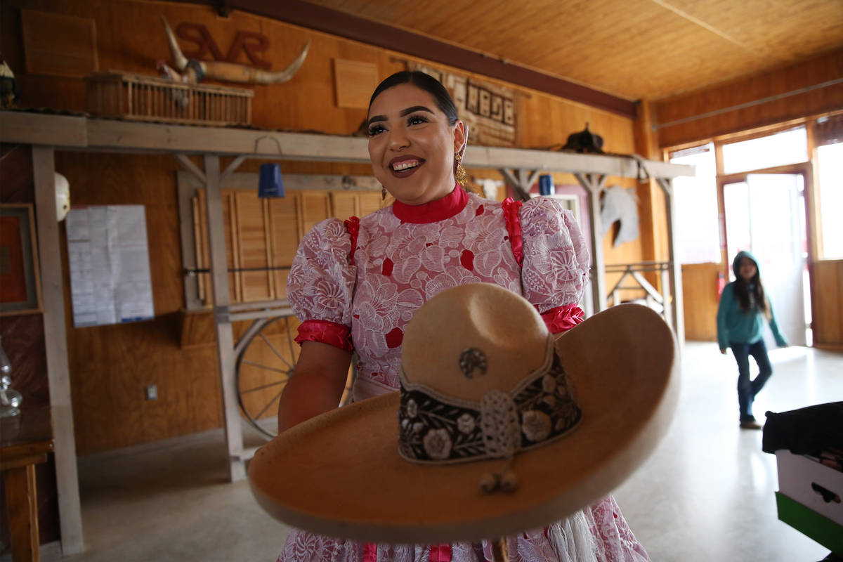 Vanessa Jauregui, 24, shows off her sombrero while preparing for a performance in February. (Er ...