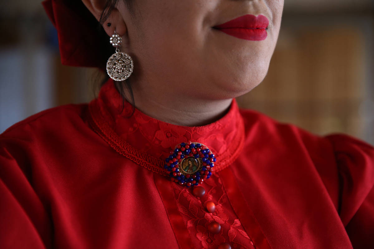 Denyse Cabrera, 18, is ready to perform after attending to final details of her apparel. (Erik ...