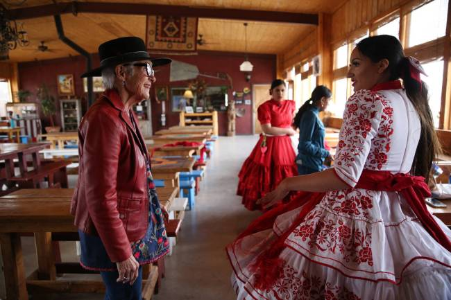 Alondra Colon, 23, right, talks to Marilyn Gubler, owner and founder of Sandy Valley Ranch, whi ...