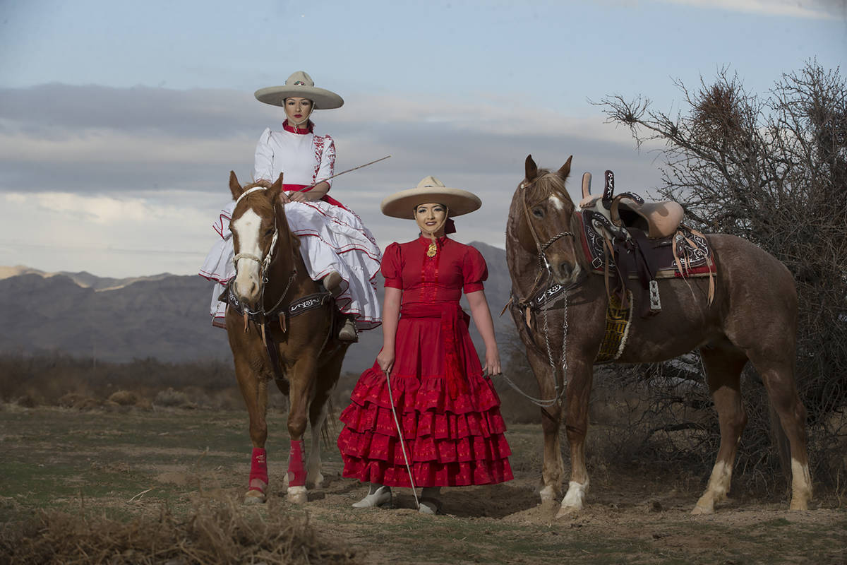 Alondra Colon, left, and her sister Viridiana, pose at Sandy Valley Ranch following their perfo ...